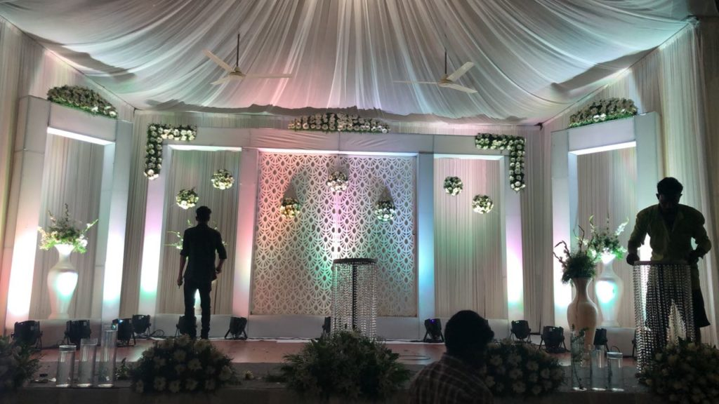 White Stage Decoration For Christian Weddings