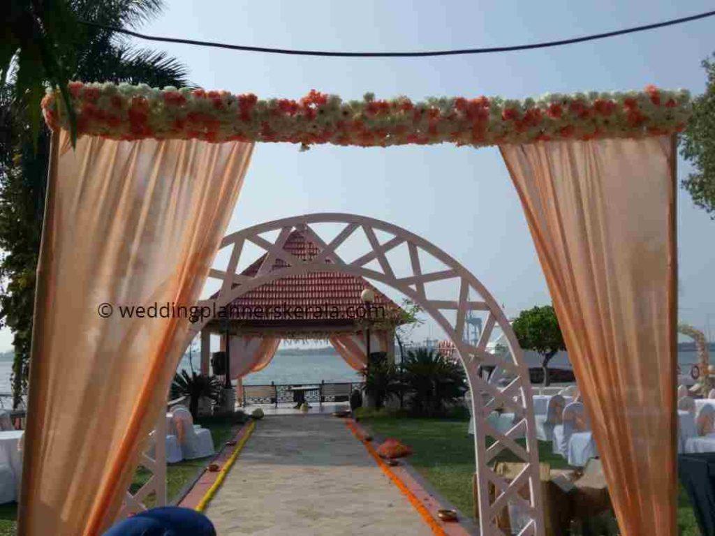 Peach Color Theme Wedding Entrance Decoration Kerala Wedding Planners